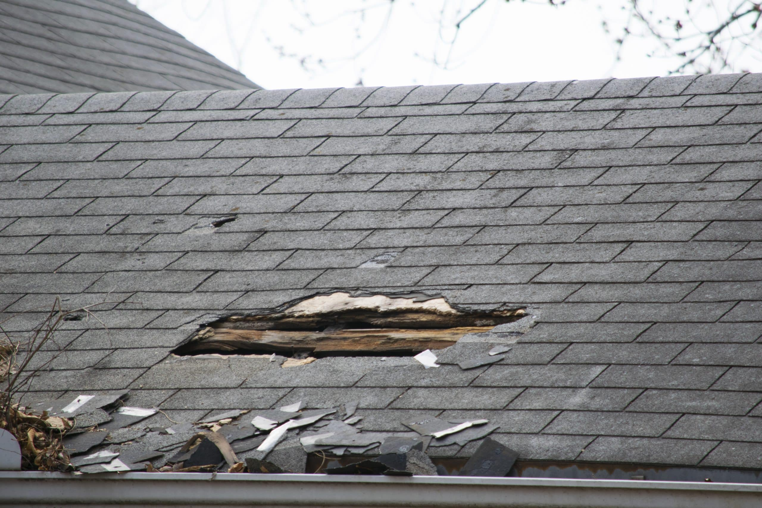 roof storm damage || hole in roof
